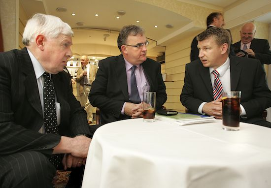 Alan Ashenhurst left and Gordon Donaldson, right have a discussion with Seamus Carr from Vion after he spoke at the NI Grain Trade Association meeting.